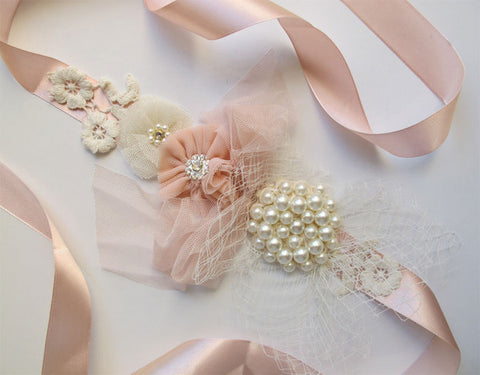 Ivory & pink sash with flower and pearls