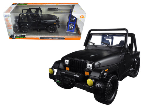 "1992 Jeep Wrangler ""Just Trucks\"" with Extra Wheels Matt Black 1/24 Diecast Model Car by Jada"