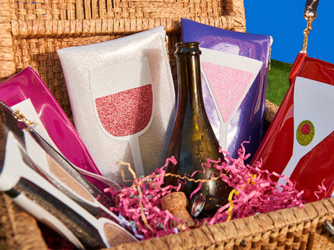 cocktail clutches in a basket with champagne