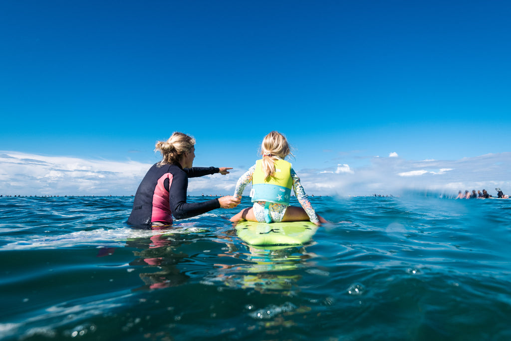 MUM AND DAUGHTER AT PEP-11 PADDLE OUT