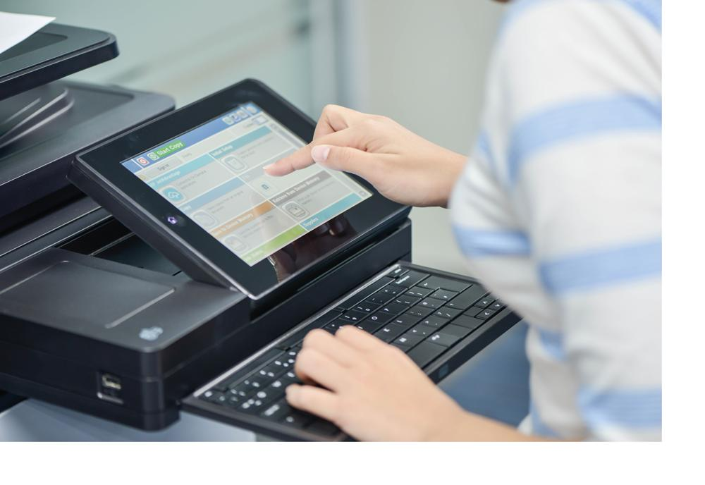 Office worker using HP printer to scan and copy secure documents