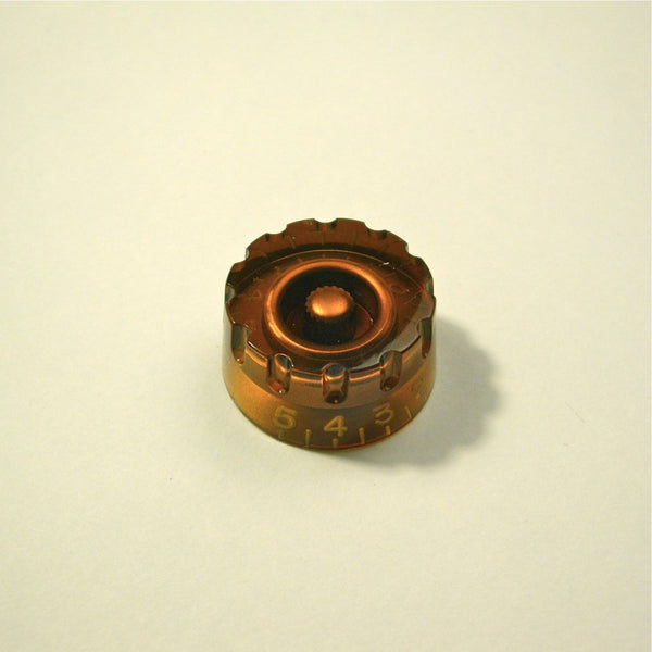 Volume/tone speed knob (hatbox-type, notched edge), transparent amber