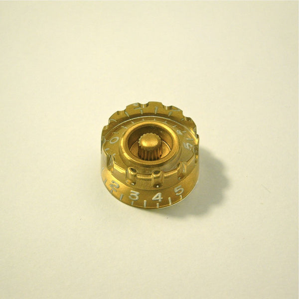 Volume/tone speed knob (hatbox-type, notched edge), transparent gold
