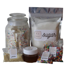 Load image into Gallery viewer, ingredients in the marshmallow making kit, bag of sugar, jar of honey, packs of gelatin and sprinkles