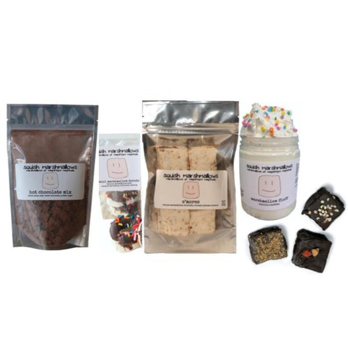 Comfort Kit displayed with a pack of hot chocolate mix, a box of mini marshmallow donuts, a 6-pack bag of marshmallows, a jar of marshmallow fluff, and 3 chocolate dipped marshmallows.