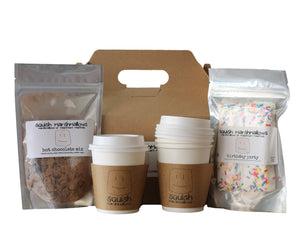 Display of items in the DIY hot chocolate kit. Includes one packet of hot chocolate mix, one package of marshmallows, gift box, and 4 small to-go cups