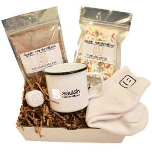 cozy kit includes logo mug, logo white socks, logo white lip balm, pack of hot chocolate mix, and pack of marshmallows