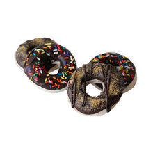 Load image into Gallery viewer, Marshmallows in the shape of medium sized donuts, with a chocolate coating