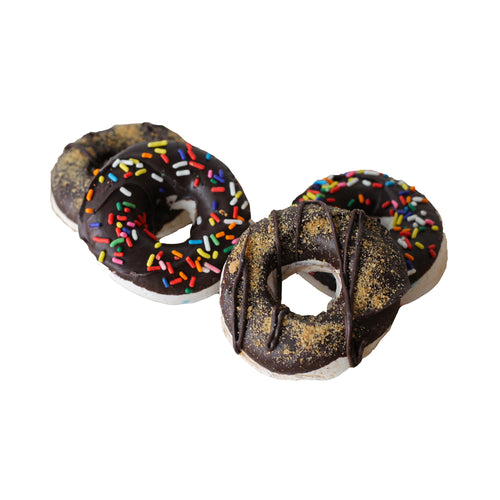 Marshmallows in the shape of medium sized donuts, with a chocolate coating