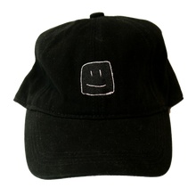 Load image into Gallery viewer, Black baseball cap with white stitching of the Squish Marshmallows logo in front, and name in the back