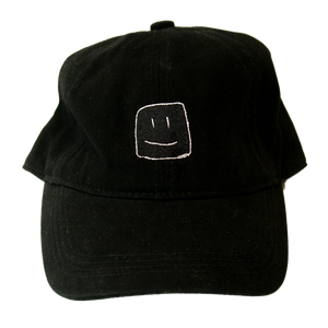 Black baseball cap with white stitching of the Squish Marshmallows logo in front, and name in the back