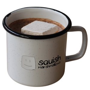 logo mug with hot chocolate and a marshmallow