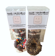 Load image into Gallery viewer, Small clear gift box with mini marshmallow donuts inside, and a logo label around the box