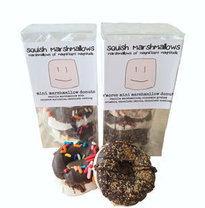 Small clear gift box with mini marshmallow donuts inside, and a logo label around the box