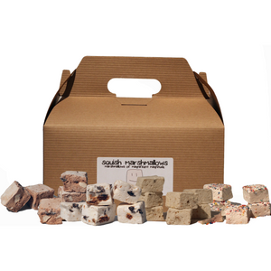 Brown kraft gable box with a variety of square marshmallows in different flavors Banana Pudding, Birthday Party, Rocky Road, and S'Mores