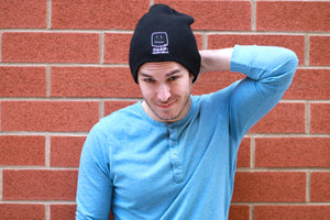 Male model wearing the beanie, smiling