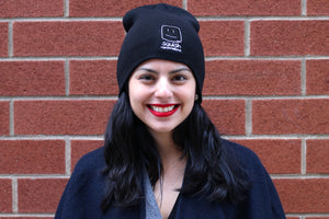Female model wearing the beanie, smiling