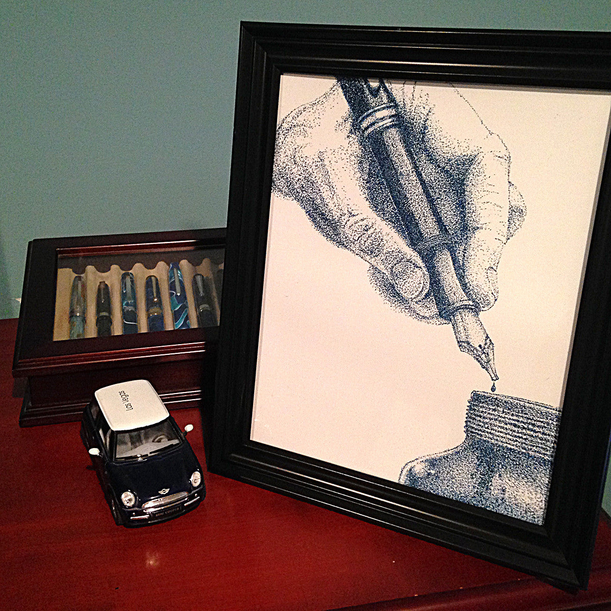 Blue Dots Fountain Pen Print Framed and on a Desk