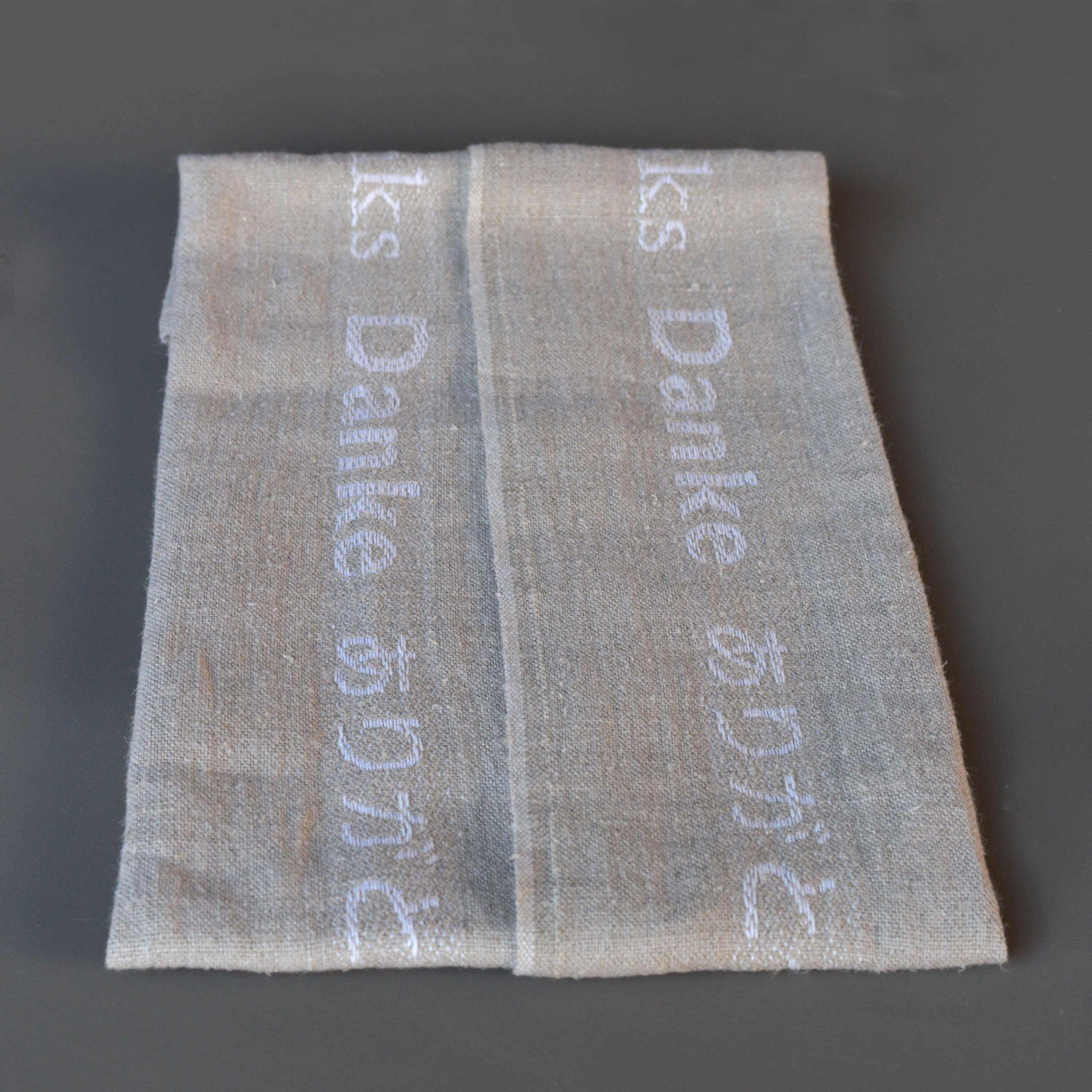 French 100% Linen Natural with White Merci Text Tea Towel by Charvet Editions