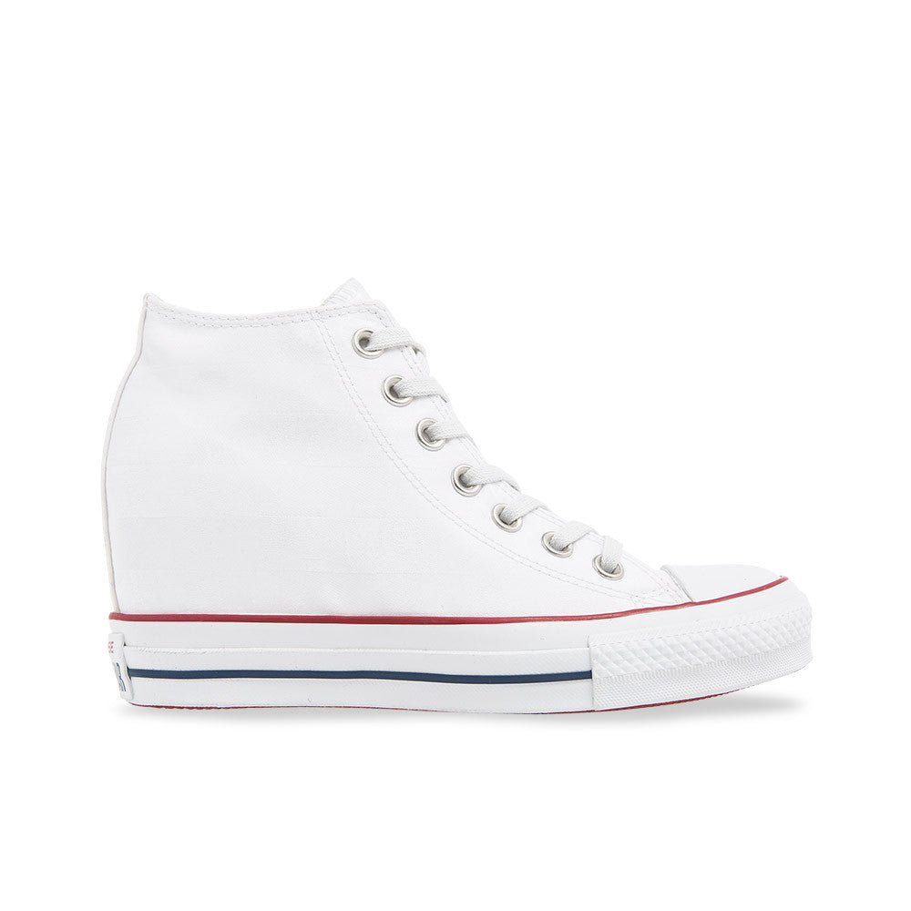 4eae0f47c80 Converse Chuck Taylor All Star Lux Mid Wedge White This Wedge sneaker has a  flag pattern ...