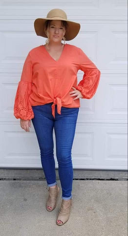 Bubble sleeve top in coral