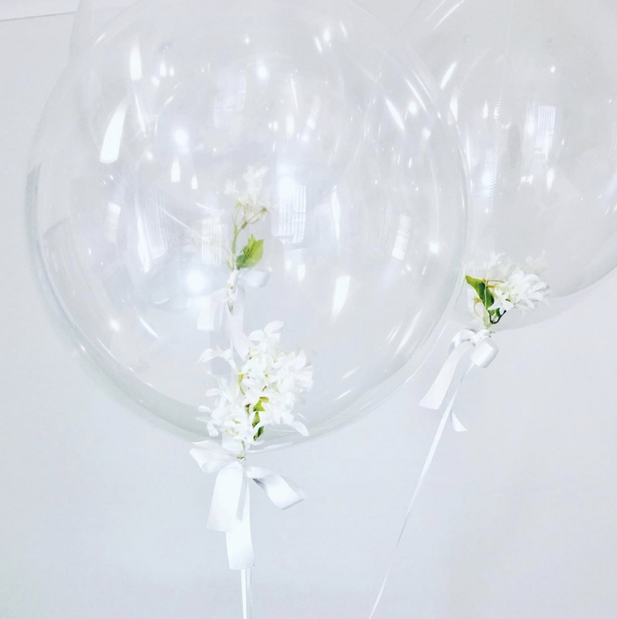 Flowers inside balloons