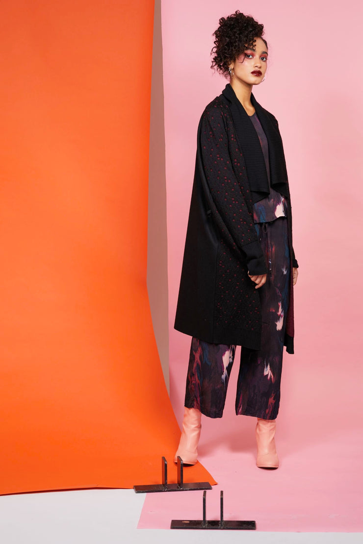 Maaike merino coat/Cardigan with double layered texture, wide rib collar, cuff and hem. Woven back and belt.