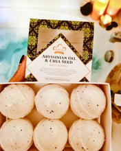 Load image into Gallery viewer, Nubian Heritage: Abyssinian Oil & Chia Seed Bath Bombs (Set of 6)
