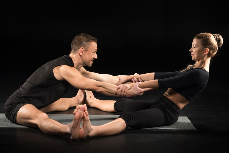 7 Partner Yoga Poses - Partner Forward-Fold