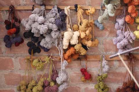 Hand-dyed wool hanging to dry.