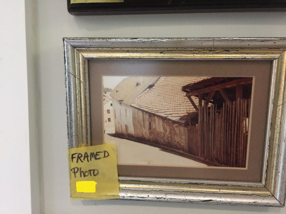 7795 - AN - Framed Photo of a old building on the side of a hill in a small town