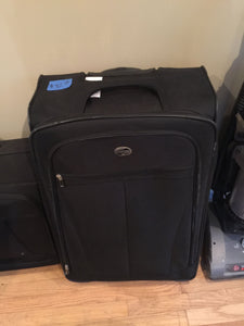 7868  - H - Large Black American Tourister Suitcase - With Telescoping Handle and Wheels