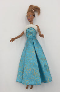 8505 - T - 1990 Barbie Doll - Dark Complextion, Redish Brown Hair with a Long Blue White Fur Top Outfit.