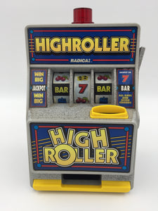 9507 - T - High Roller Toy Slot Machine - Has Working Lights and Ringing Bell - By Radica