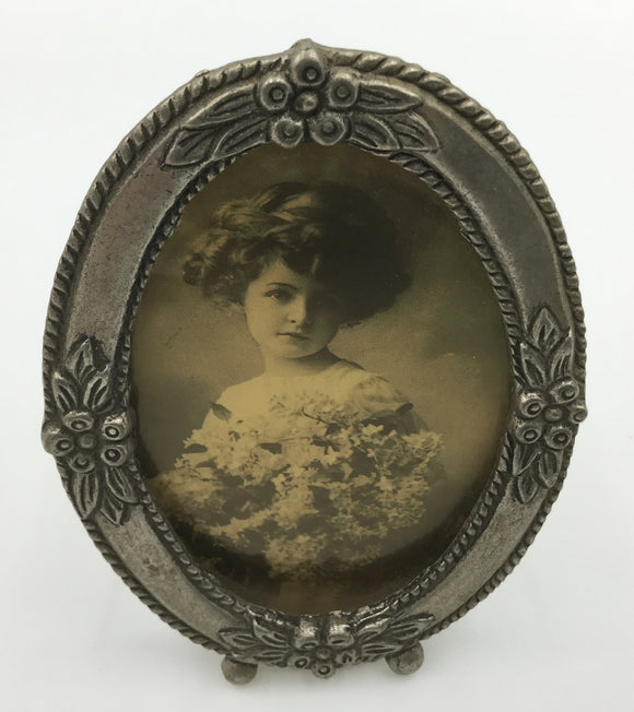 8701 - AN - Vintage Framed Photo - Girl with Flowers - Decorative Pewter Oval With Inset Flower Design