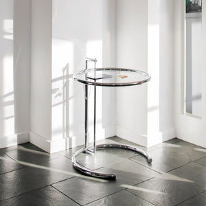 E 1027 Adjustable Table in chrome plated with clear glass top