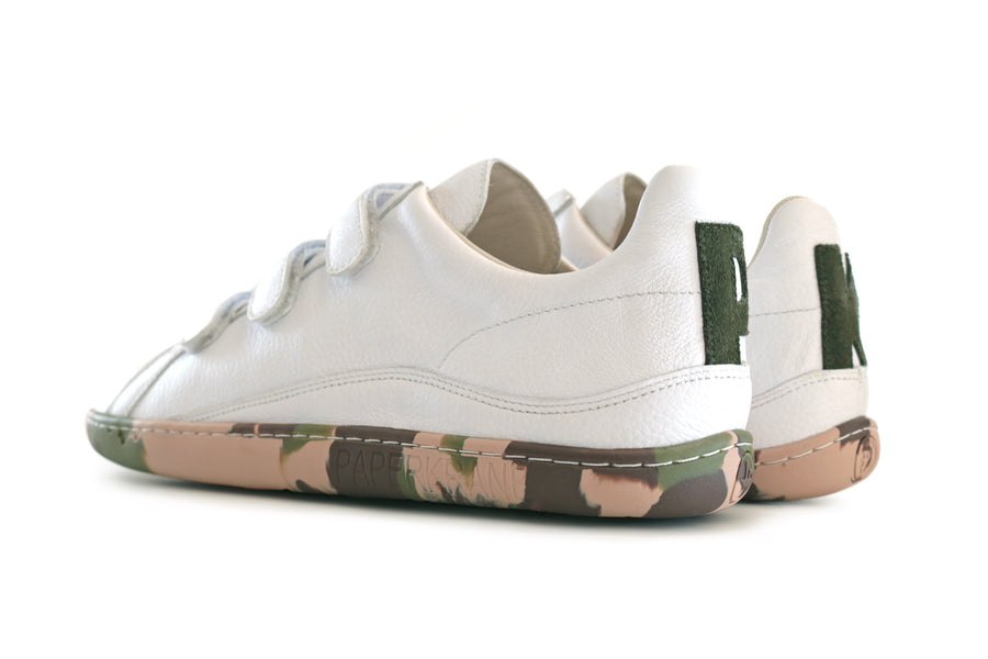 FRONT AND SIDE VIEW OF WHITE LEATHER VELCRO SHOE WITH CAMO SOLE