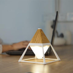 Pyramid light wood desk led lamp in living room