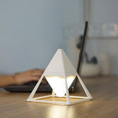 White ceramic table lamp pyramid with LED in living room