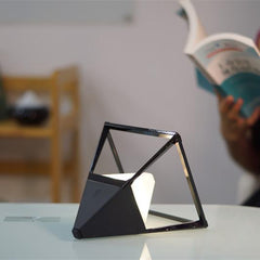 reading light mode of the black ceramic pyramid lamp