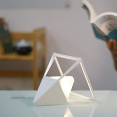 White ceramic LED table lamp pyramid as reading light