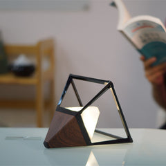 Pyramid table lamp in dark wood as reading light