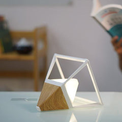 Pyramid light wood lamp as reading light