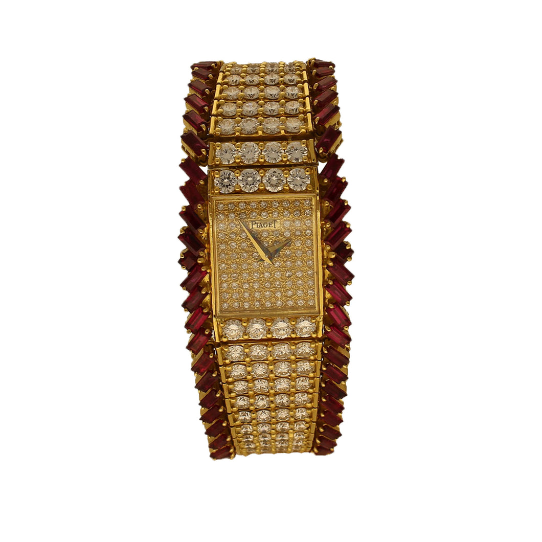 18ct yellow gold, diamond and ruby set bracelet watch. Circa 1970