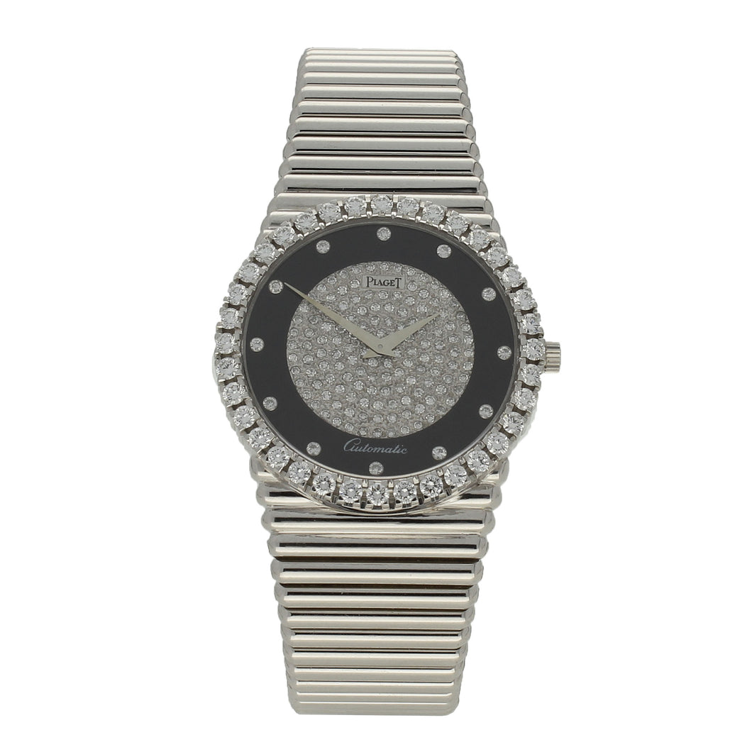 18ct white gold 'round cased' bracelet watch with diamond and onyx set dial and diamond set bezel. Circa 1970