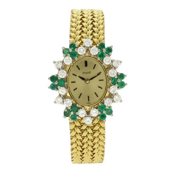 18ct yellow gold and diamond and emerald set bracelet watch by Piaget c. 1970
