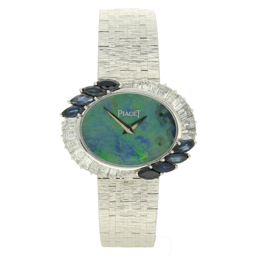 18ct white gold 'oval cased' bracelet watch with opal dial and diamond and sapphire set bezel. Circa 1970
