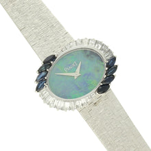 Load image into Gallery viewer, 18ct white gold 'oval cased' bracelet watch with opal dial and diamond and sapphire set bezel. Circa 1970