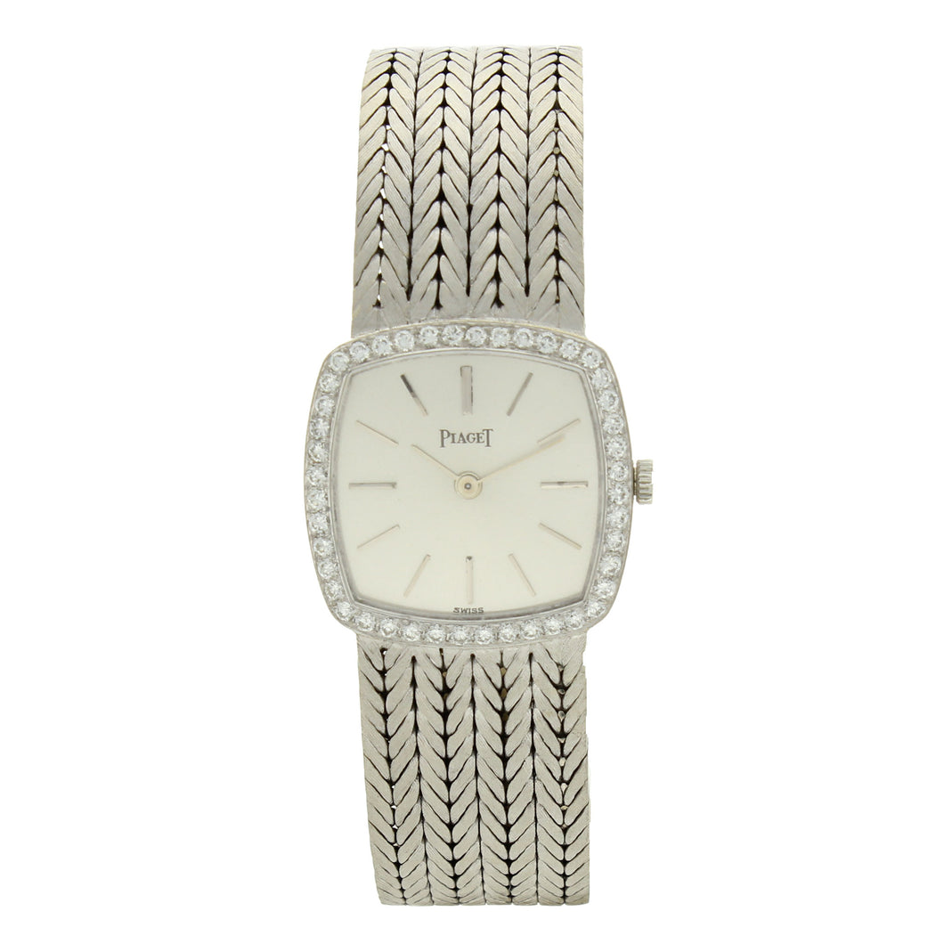 18ct white gold 'cushion cased' bracelet watch with silvered dial and diamond set bezel. Circa 1970