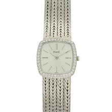 Load image into Gallery viewer, 18ct white gold 'cushion cased' bracelet watch with silvered dial and diamond set bezel. Circa 1970